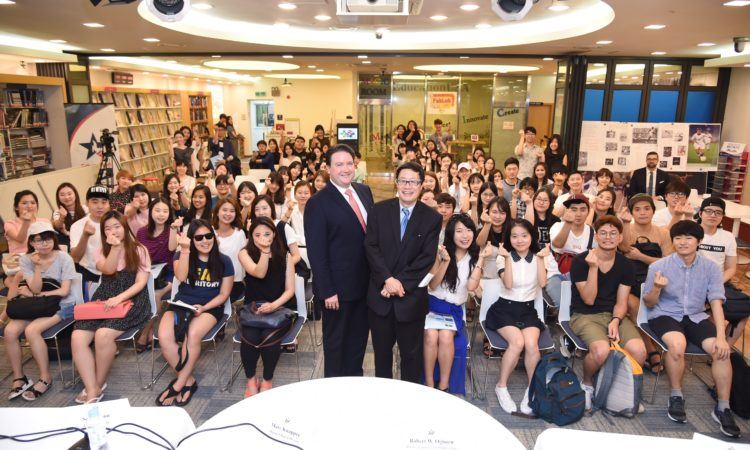 "U.S. Deputy Chief of Mission Marc Knapper (left) and Minister-Counselor for Public Affairs Robert Ogburn (right) pose with program participants after finishing the Embassy Youth Forum: Real People Talking event on ""Current Trends in U.S.-Korea Relations And Career Paths and the Life of a Diplomat, including His Role as DCM"" at the American Center Korea."