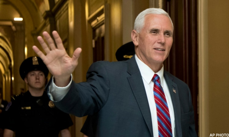 Sean Spicer, Mike Pence - Vice President Mike Pence waves as he walks past reporters in a U.S. Capitol hallway in Washington, Monday, May 1, 2017. (AP Photo/Manuel Balce Ceneta)